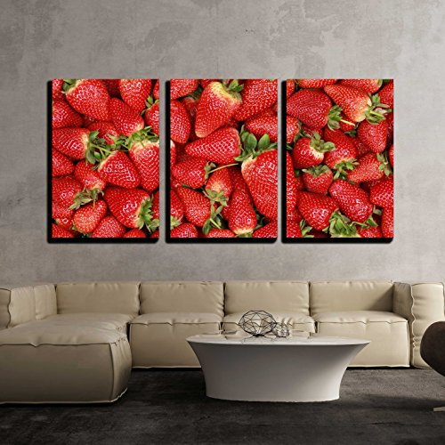 Collection of Freshly Harvested Strawberries Forming a Background with Copy Space x3 Panels