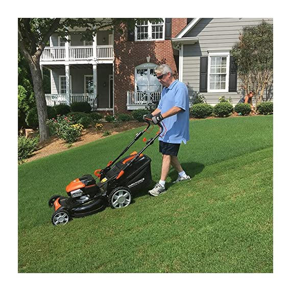 "Yard Force YOLMX225300 120V 2.5Ah x 2 Lithium-Ion 22"" SP 3-in-1 Mower Torque-Sense, One Size, Black/Orange 4 POWERFUL, RELIABLE PERFORMANCE + 5-YEAR WARRANTY: The 120vRX brushless motor has the torque of a gas engine to cut through all grass types and conditions with up to 100 minutes of runtime on a single charge with two batteries installed. Dual battery ports operate either battery when two are installed. When one is completely discharged, the sensor powers the other battery to keep you going. The mower operates with only one battery installed if you need to charge the other battery while cutting. TORQUE-SENSE TECHNOLOGY: Sensors built in to the motor receive feedback while you are cutting and sense when more power is needed for thick, dense or wet grass to increase the blade speed for a premium cut. This gives you power when you need it and saves energy when you don't to extend the runtime even longer. SELF-PROPELLED / SPEED ADJUSTABLE DRIVE: Step up to self-propelled power drive with a simple control lever on the handle to reduce effort and achieve a perfect cut every time! Adjust the speed with the touch of a lever at your fingertips. Self-propelled drive is essential for yards with hills and slopes of all degrees to maintain a consistent cut and is safer by providing more control during operation."