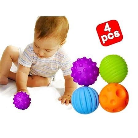 Bebé que sostiene la bola Conjunto de bola sensorial textura multi ...