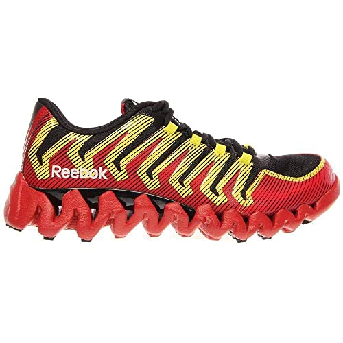 ca5b20704108ac Amazon.com  REEBOK Boy s Grade School ZigTech Shark 2.0 Black Red Yellow  Running Shoes