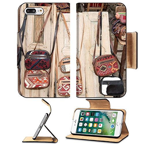 MSD Premium Apple iPhone 7 Plus Flip Pu Leather Wallet Case An assortment of different hand made woven and leather handbags hanging over wooden doors …