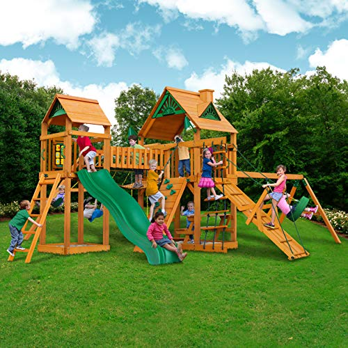 Pioneer Peak Cedar Swing and Play Set w/ Wave Slide, Rock Climbing Wall, Picnic Table, Two Swings, Ring/Trapeze Swing, Sandbox, Bridge and Tower, Tire Swing, Rope Ladder and More! ()