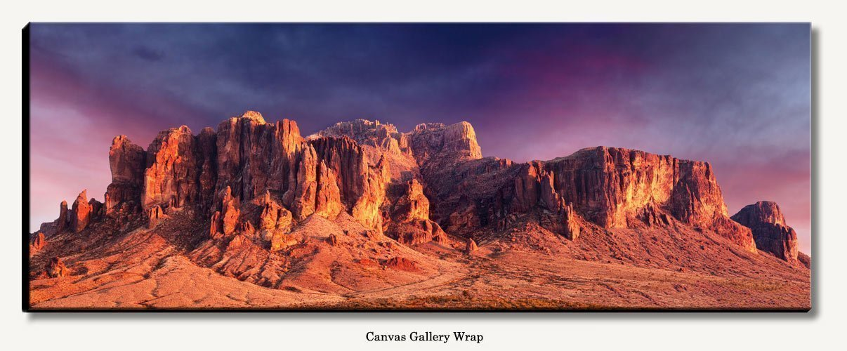 Large panoramic gallery wrapped canvas photograph of Superstition Mountains during sunset in Apache Junction Arizona sized 19'' x 50'' with 1.5'' deep black sides. Panorama wired ready to hang.