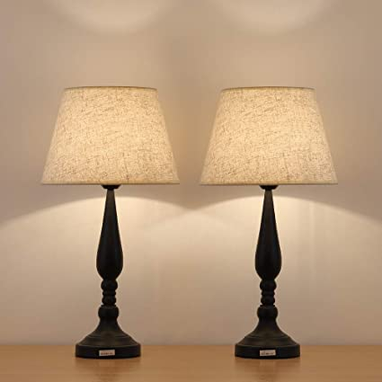 Pair of cream lamps on modern cupboard in contemporary ...