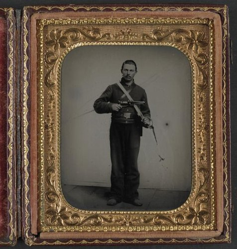 Photo: Unidentified soldier in Union cavalry uniform with Colt Dragoon revolver, sword . Size: 8x10