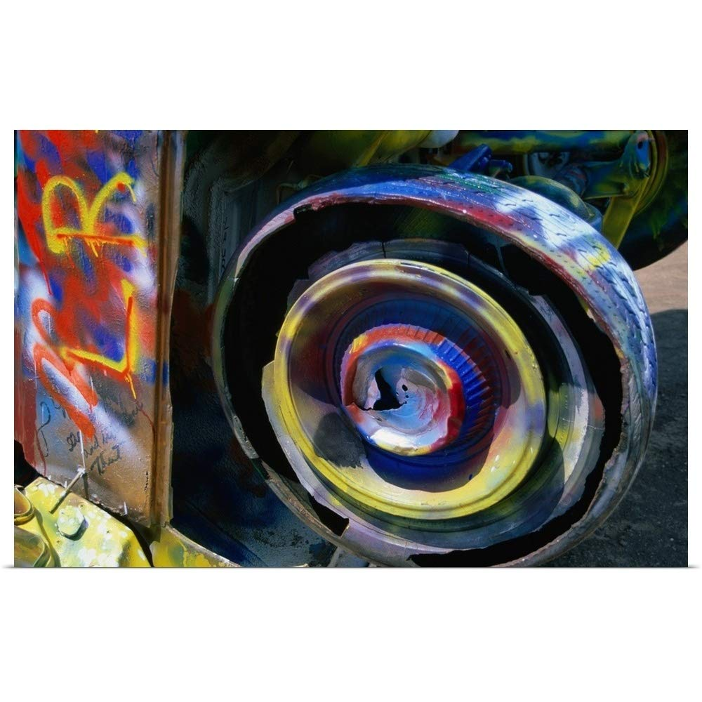 """GREATBIGCANVAS Poster Print Entitled Wheel of a Half-Buried Cadillac Covered in Graffiti, Cadillac Ranch Monument. by 18""""x12"""""""