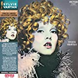 """This album was orchestrated by Tommy BROWN and Micky JONES (founder member of the band FOREIGNER) It includes English tracks and a passage from the Sacha-Sylvie Show recorded in December 1969 : """"""""Ma petite ombre"""""""", """"""""Apprends-moi"""""""", """"""""Si jéta..."""