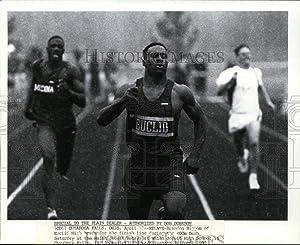 Historic Images - 1993 Vintage Press Photo Brandon Biggom of Euclid High head for the 400m Dash finish