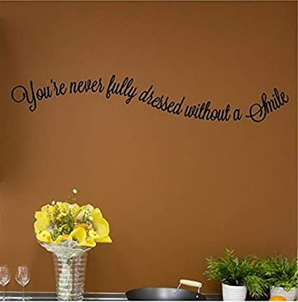 com you re never fully dressed out a smile quotes wall