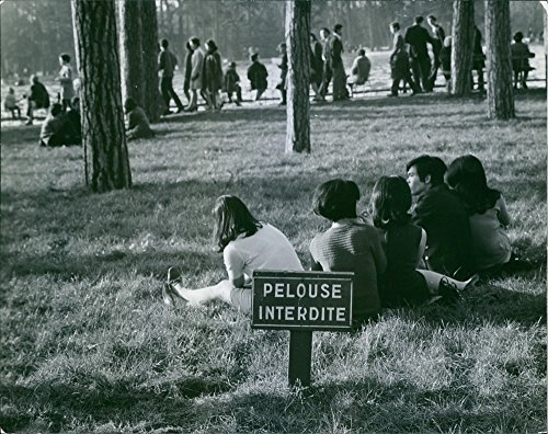 vintage-photo-of-people-on-a-park-with-a-sign-saying-pelouse-interdite