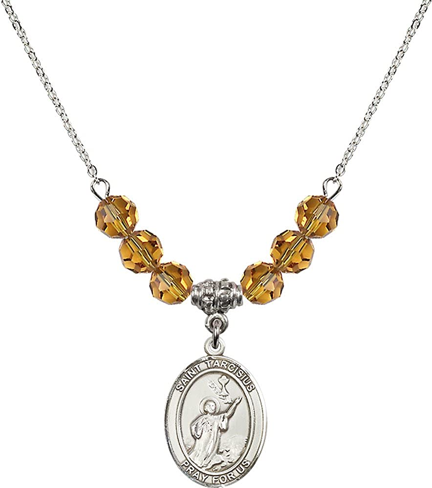 18-Inch Rhodium Plated Necklace with 6mm Topaz Birthstone Beads and Sterling Silver Saint Tarcisius Charm.