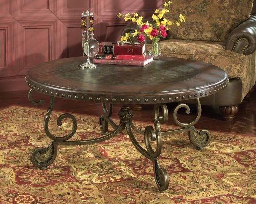 signature-design-by-ashley-rafferty-round-cocktail-table-dark-brown