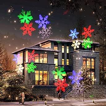 COOSA Luces Proyector Navidad LED,12 Diapositivas Exclusivamente Diseñadas, (RGBW 4 Colores LED) Luces Decorativas para Navidad ,Año Nuevo, ...