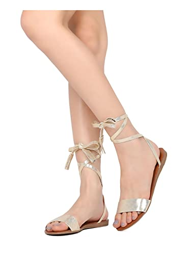 796a8adbb12 Image Unavailable. Image not available for. Color  Breckelles Aloha  Champagne Metallic Open Toe Ankle Wrap Tasseled Gladiator Sandal ...