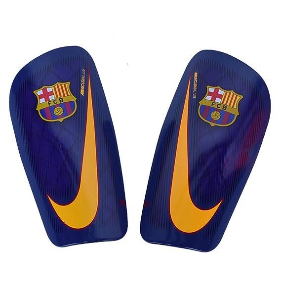 a6d94e4cd14 Nike FCB Nk Merc Lt Espinilleras FC Barcelona, Unisex Adulto: Amazon.es:  Ropa y accesorios