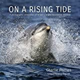 img - for On a Rising Tide: A Photographic Celebration of Britain's Largest Bottlenose Dolphins book / textbook / text book