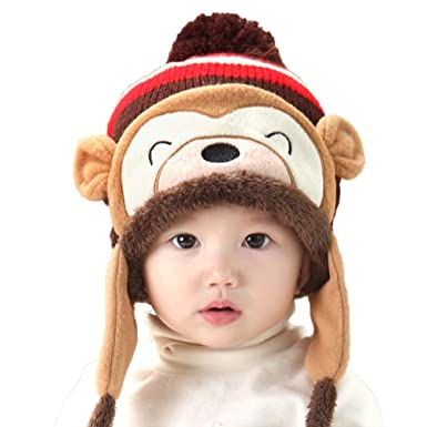 668403fdd30 HuntGold Cute Baby Toddler Winter Warm Monkey Pom Pom Beanie Hat Earflap  Knitted Cap New(Coffee)  Amazon.co.uk  Clothing