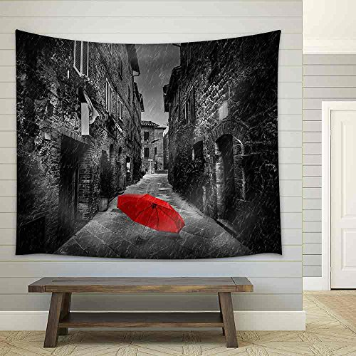 Umbrella on Dark Narrow Street in an Old Italian Town in Tuscany Italy Raining Black and White with Red Fabric Wall