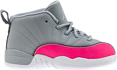 pink and white jordan retro 12