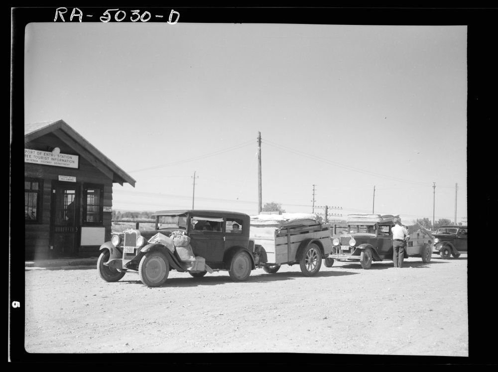Everyday from twenty to thirty cars moving out from the Dakotas pass the Montana Highway Department's port of entry. Montana by Historic Photos