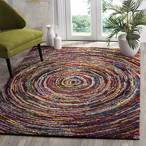 bright multi colored area rugs that add interest pattern. Black Bedroom Furniture Sets. Home Design Ideas