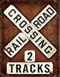 "Railroad Crossing Tin 2 Tracks SignTrain and railway enthusiasts will want to add this authentically-distressed sign to their displays and collections. Measures appx: 12.5"" x 16"". Predrilled and ready to mount."