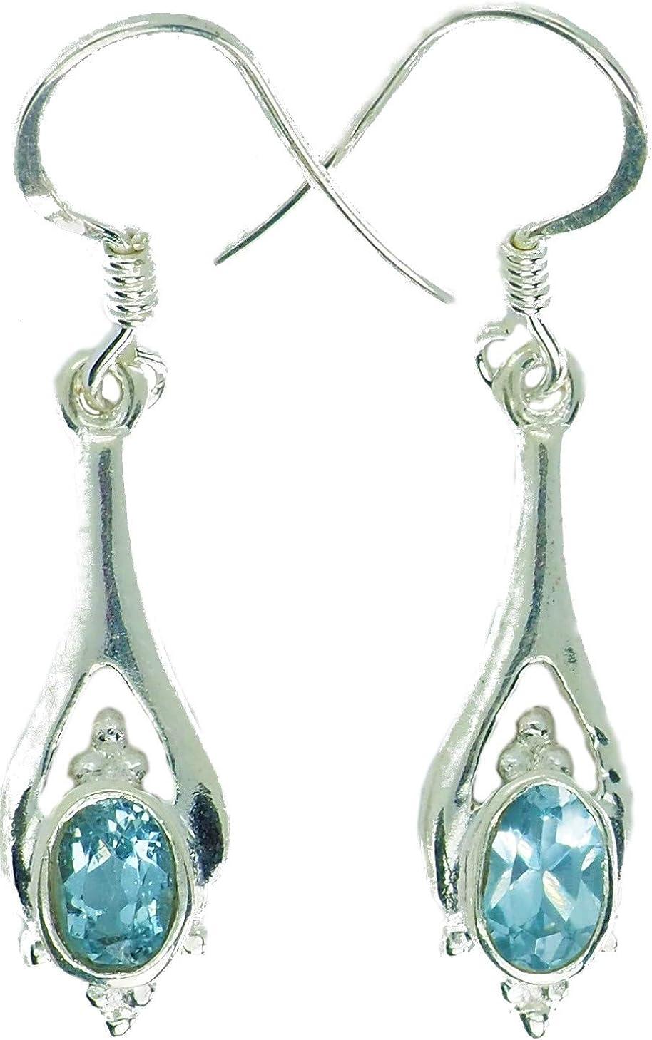 Pendientes con auténtica piedra preciosa azul topacio engarzado en plata de ley 925, los pendientes son de 3,60 cm de largo y 0,70 cm de ancho + 2 topes de silicona gratis