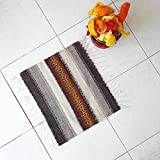 Small handwoven wool rug in natural colors and red, yellow and orange for your home decor by Rugs N' Bags