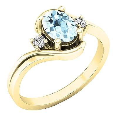 1b02f4fea228 10 K oro amarillo - anillo de compromiso 3 piedra  Amazon.es  Joyería