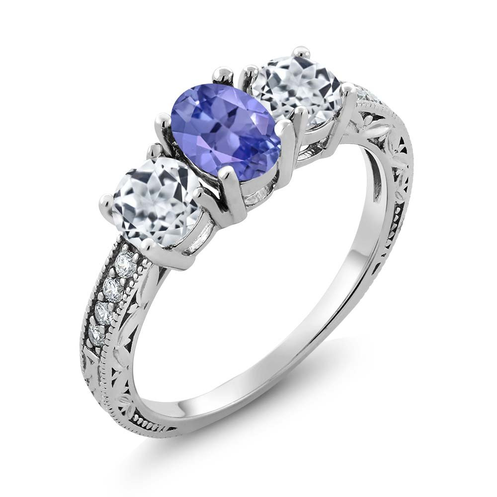 1.87 Ct Oval Blue Tanzanite and White Topaz 925 Sterling Silver Women's 3-Stone Ring (Available in size 5, 6, 7, 8, 9) MGZ-0355-OV-TZ-BL-T-W-CZ-W-SS