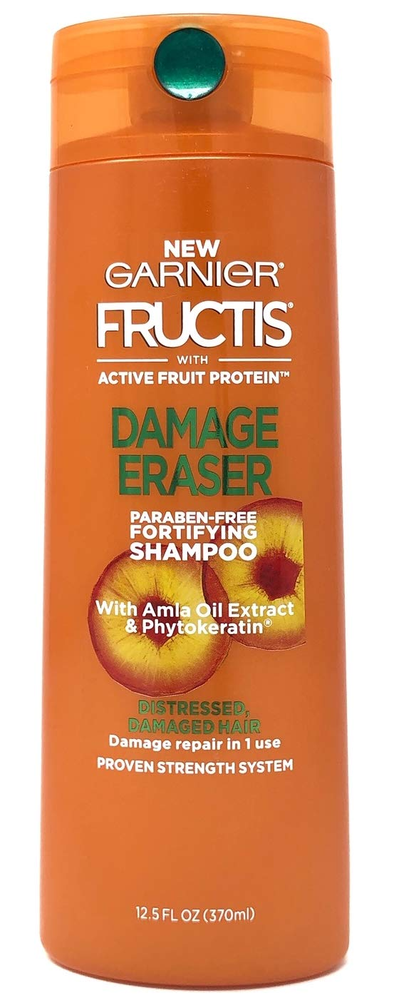 Amazon.com : Garnier Fructis Damage Eraser Shampoo (12.5 oz) & Conditioner (12 oz) Bundle with Silicone Travel Bottle : Beauty