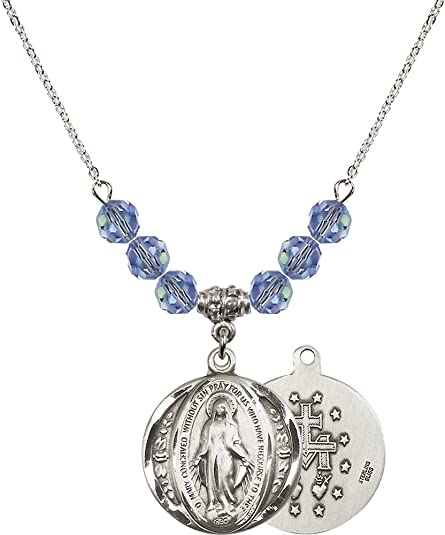 18-Inch Rhodium Plated Necklace with 6mm Emerald Birthstone Beads and Sterling Silver Saint Josephine Bakhita Charm.