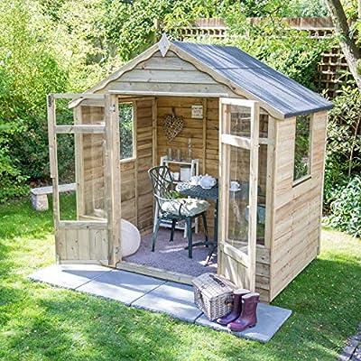 7 x 5 garden apex summerhouse in a garden with trendy furniture inside