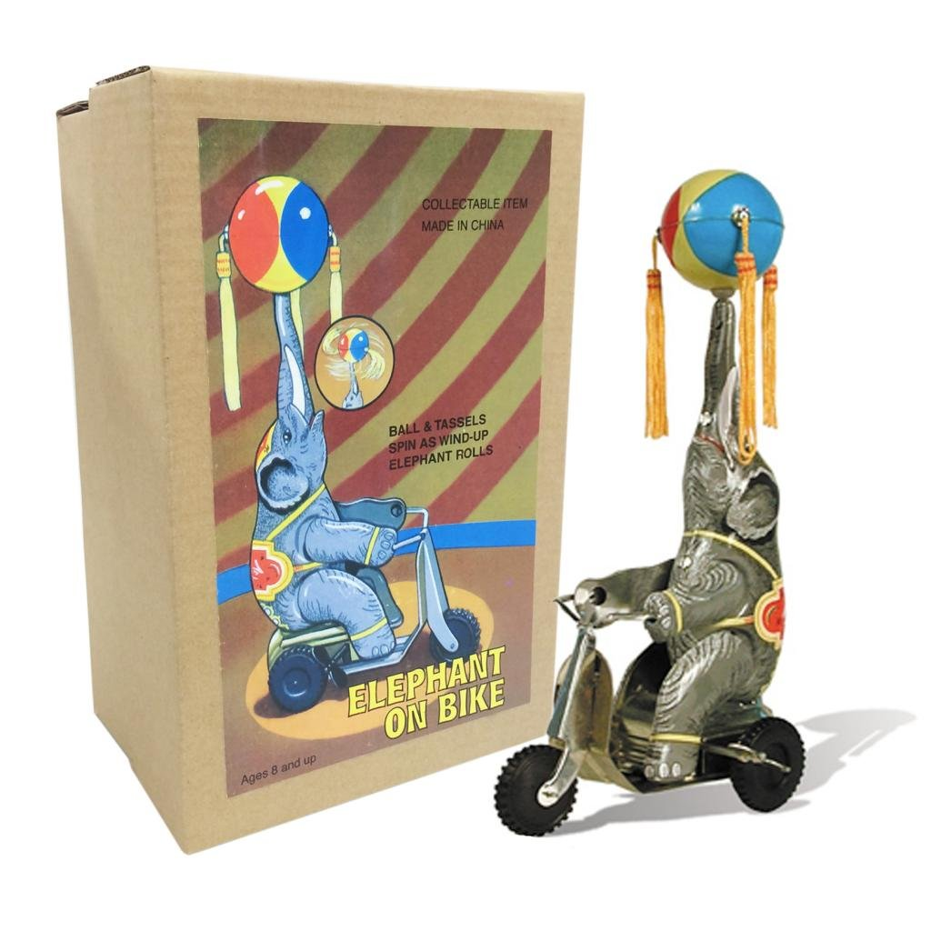 Vintage Style Elephant On Bike Off the Wall Toys