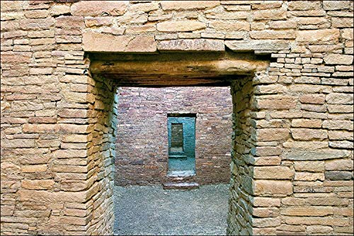 Native American ancient stone walls at the Pueblo Bonito Ruin at Chaco Canyon, New Mexico. Art décor architectural photography showing rooms connected by multiple doors.