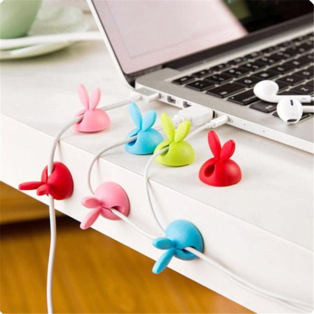 Charger cords with colored bunny-ear holders organizing the cords.