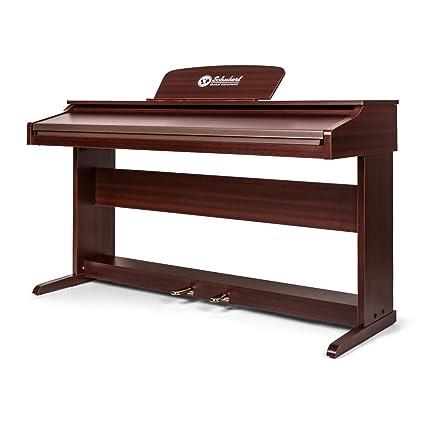 Schubert Subi88P2 Piano digital de pared • 88 teclas sensibles al tacto • 2 pedales • 138 instrumentos • Pantalla LCD • MIDI • AUX • Memoria interna para ...