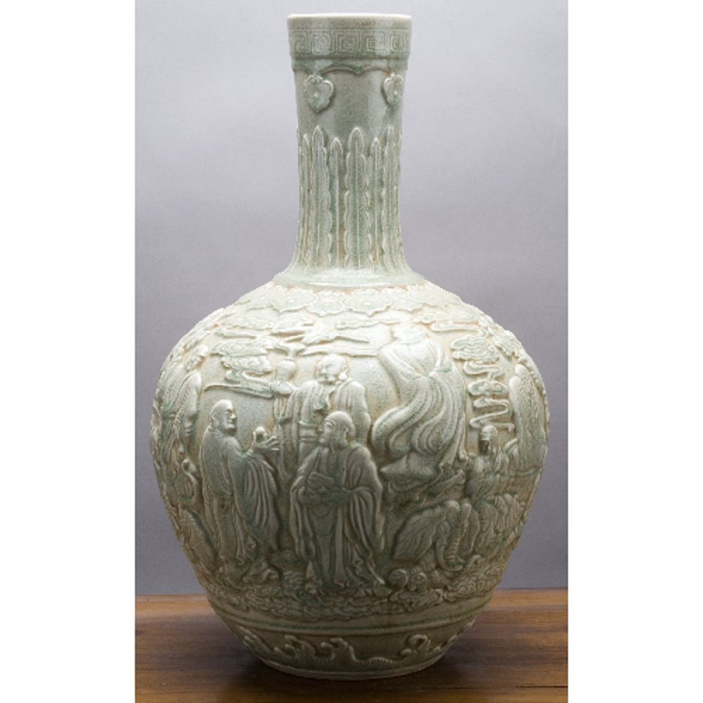 Home decor. Ivory Porcelain Round Belly Carved Vase. Dimension: 14 x 14 x 22. Pattern: Celadon Classic.