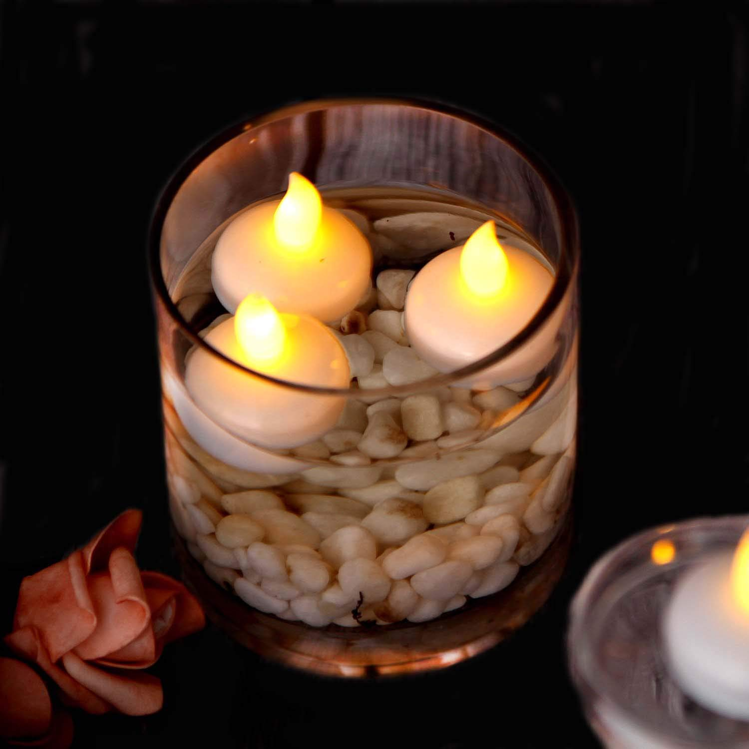 Tker Floating Flameless Candles, Waterproof Flickering LED Tea Lights Battery Operated for Wedding Party Pool SPA - Warm White