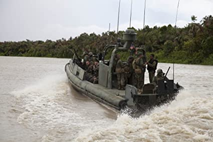 Posterazzi A Navy riverine Patrol Boat conducts Amphibious Assault Exercise in Turbo Colombia Poster Print,