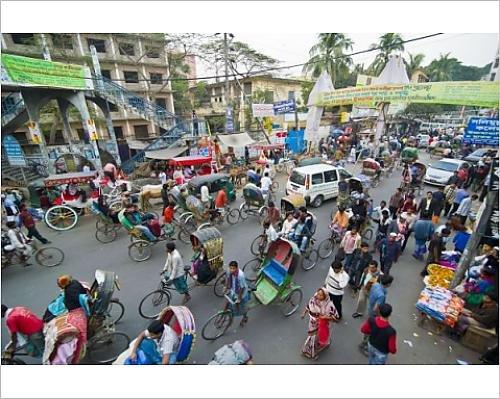 Photographic Print of Busy rickshaw traffic on a street crossing in Dhaka, Bangladesh, Asia