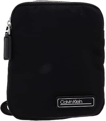 حقيبة طويلة تمر بالجسم بتصميم اساسي صغيرة الحجم من كالفن كلاين مناسبة للسفر والامتعة، 19 سم، K50K505525