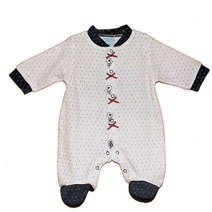 Diseño de lunares de puntos de fotos de bebé chica de espaldas en ropa blanca y