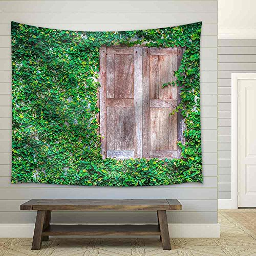 View of a Closed Wood Window and of a Wall Covered with Ivy Fabric Wall