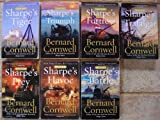 img - for The Sharpe Novels: Set of 7 Books (Sharpe's Tiger (India 1799) ~ Sharpe's Fortress (India 1803) ~ Sharpe's Triumph (India 1803) ~ Sharpe's Trafalgar (Spain 1805) ~ Sharpe's Prey (Denmark 1807) ~ Sharpe's Havoc (Portugal 1809) ~ Sharpe's Battle (Spain 1811)) book / textbook / text book