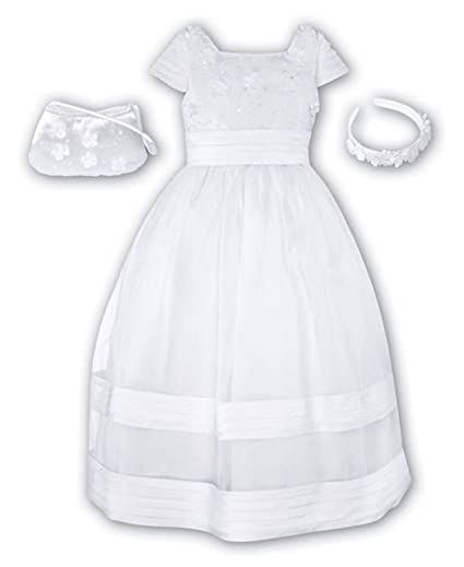 De felicitación para bautizo/chica de espaldas en ropa Comunión vestido de color blanco a