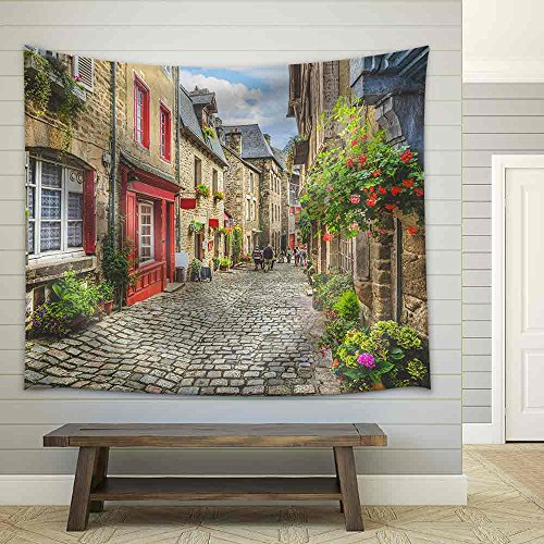 Beautiful View of Scenic Narrow Alley with Historic Traditional Houses and Cobbled Street in an Old Town in Europe Fabric Wall