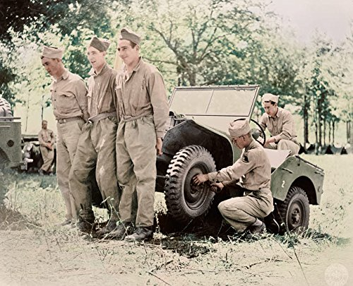 American soldiers lifting a jeep to repair it at their bivouac area 1941 Poster Print by Stocktrek Images (17 x 11) ()
