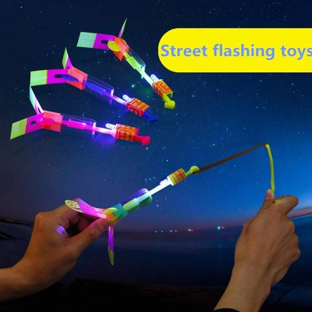 CHIGANT 2PCS Arrow Rocket Copters LED light Helicopter Flying Toy Elastic Powered Sling shot Heli Slingshot frecce a Flare Copter (Colore casuale)