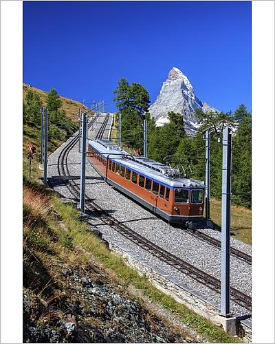 Scenic Route Background (10x8 Print of The swiss Bahn train runs on its route with the Matterhorn in the background (12075830))